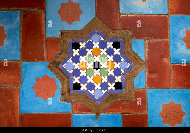 Ceramic tiles, gleaming and colourful, are used for floors and walls. Morocco - Stock Image