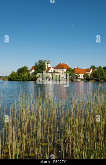 Seeon Abbey in Seeoner See lake, Seeon-Seebruck, Chiemgau, Upper Bavaria, Bavaria, Germany - Stock Image