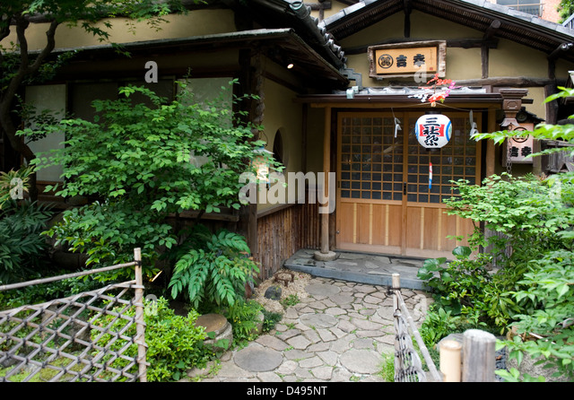 This traditional style building survived progress and development in the heart of downtown Tokyo. - Stock Image