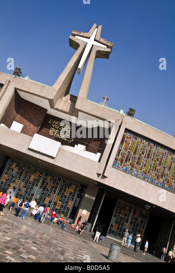 The circular-shaped New Basilica de Guadalupe. Mexico City. Doors and stained glass windows surrounding the whole - Stock Image