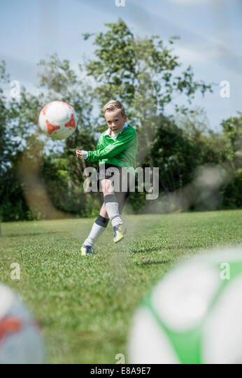 Young junior boy soccer player practicing penalty - Stock Image