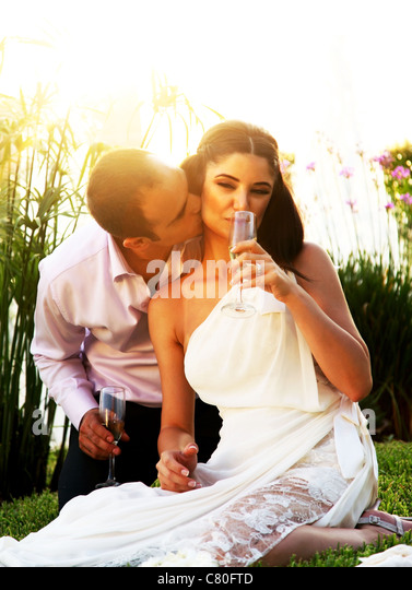 Happy young couple kissing outdoors, wedding day - Stock-Bilder