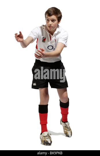 Boy with a rugby ball - Stock Image