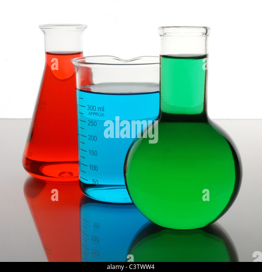 laboratory beaker and flasks containing red, blue, green liquids - Stock-Bilder