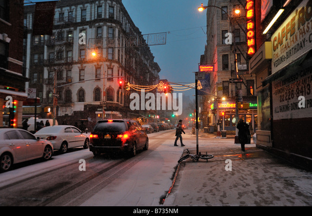 Evening snow on Mulberry Street in New York City winter in Little Italy. Stock Photo
