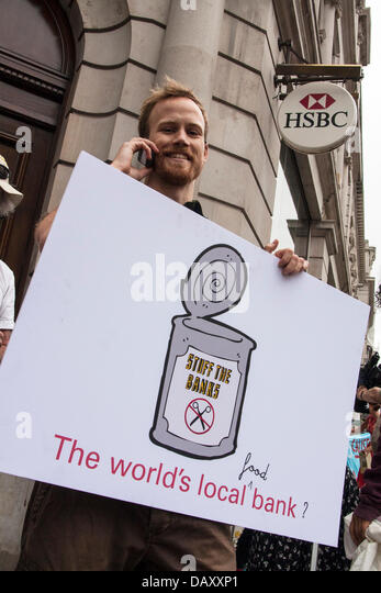 London, UK. 20th July, 2013. A protester with his placard as UK Uncut hold demonstrations outside two London branches - Stock Image