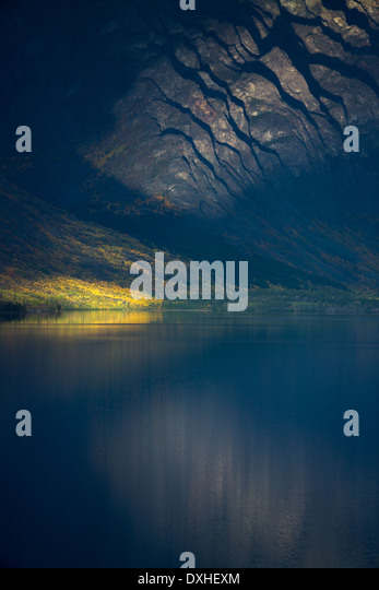 a late shaft of sunlight on Tutshi Lake, British Columbia, Canada - Stock Image