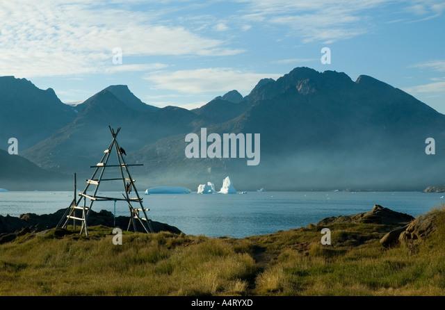 Evening mist over Kong Oscars Havn, Tasiilaq, Angmagssalik Island, Sermilik Fjord, East Greenland - Stock Image