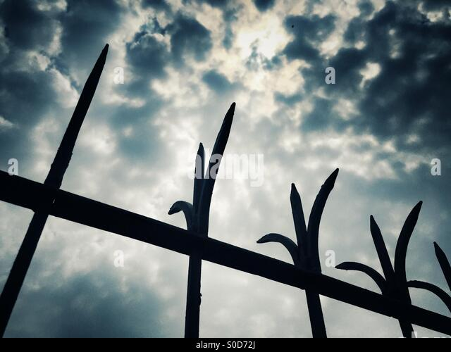 Barbed fence against dramatic sky - Stock Image