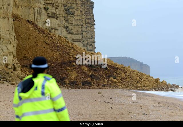 West Bay, Dorset, UK. 29th June, 2017. Police close East Beach and cliff path after a massive cliff fall at West - Stock Image