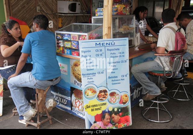 Managua Nicaragua Avenida Simon Bolivar Plaza Inter food stand kiosk counter stool snacks local fast food traditional - Stock Image
