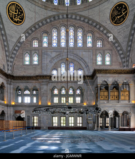 Interior facade of Nuruosmaniye Mosque, an Ottoman Baroque style mosque completed in 1755, with a huge arch & - Stock Image