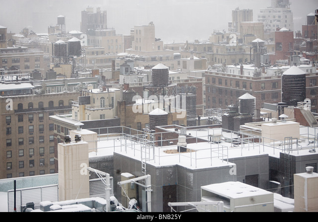 Snow on roof tops - Stock Image