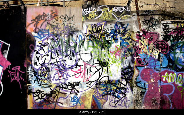 Color landscape Image of Graffiti on the Berlin Wall in Germany. - Stock-Bilder