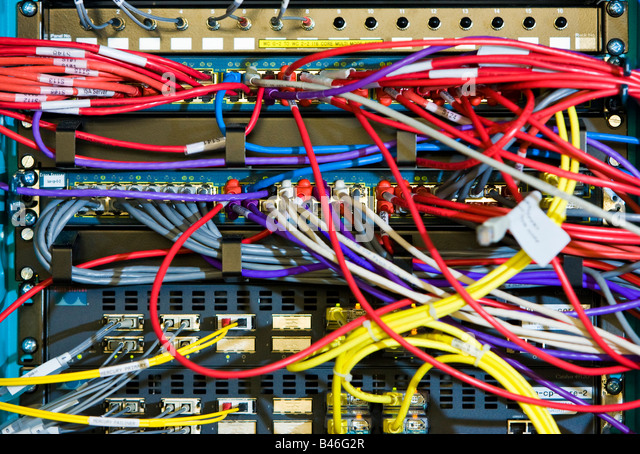 Computer cables and wires in a server rack - Stock Image