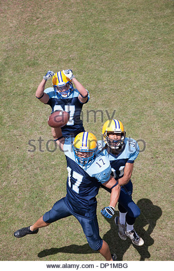 Winning football player cheering - Stock Image