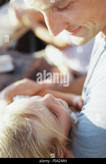 Man spending quality time with his daughter. - Stock Image
