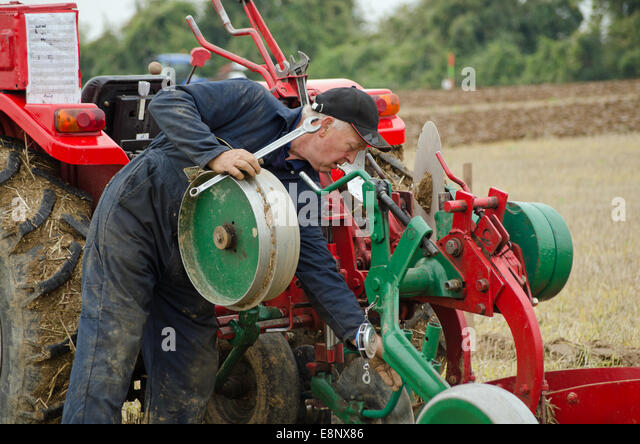 David Chappell making adjustments at British National Ploughing Championships 2014 - Stock Image