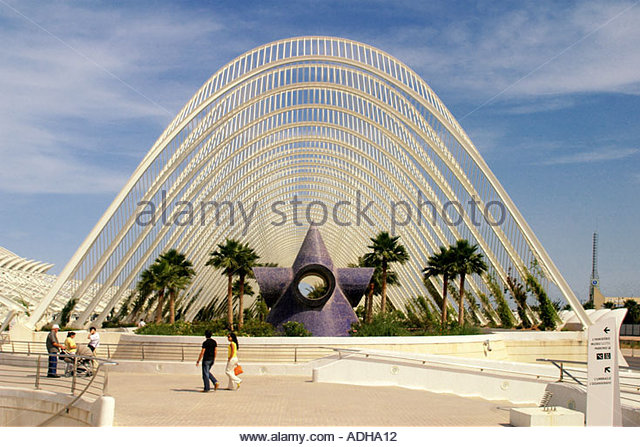Spain Valencia City of sciences and arts by architect Santiago Calatrava arches over little park - Stock Image