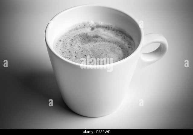 White cup of black coffee with foam, monochrome photo - Stock Image