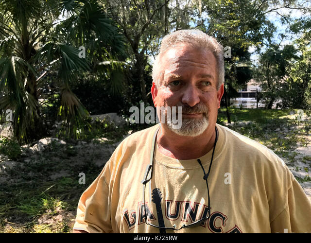 United States. 13th Sep, 2017. Middleburg resident Maury Kopman stands near his flood damaged home in Middleburg, - Stock Image