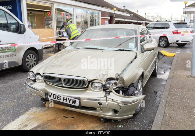 Damaged Jaguar car involved in accident in car park - Stock Image