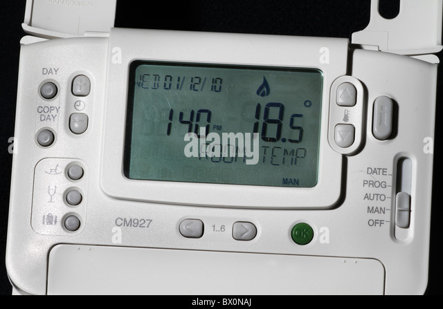 Detail of modern radio frequency WiFi heating control system thermostat. - Stock Image