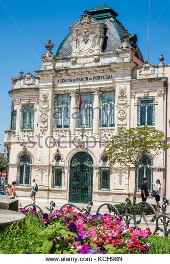 Coimbra Portugal historic center Largo da Portagem main square Banco de Portugal exterior facade landmark Adaes - Stock Image