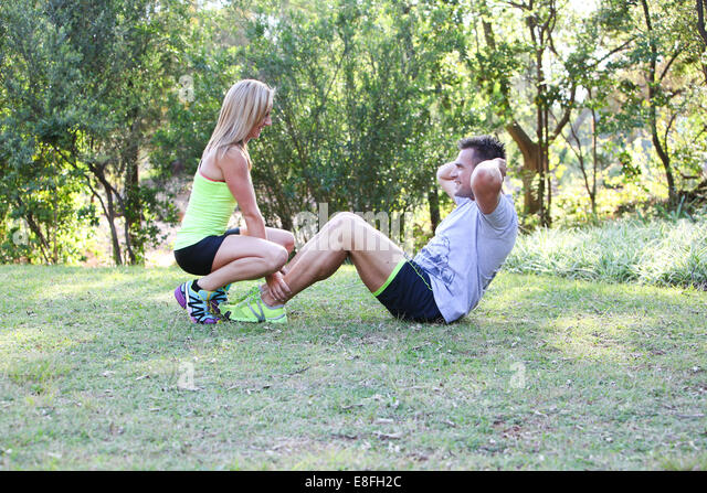 Couple training in park - Stock Image