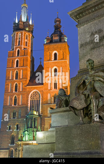 Church of St Mary and Adam Mickiewicz statue Krakow Poland - Stock Image