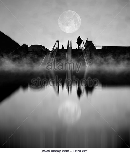 Reflection Of People On Escalator And Moon In Water - Stock Image