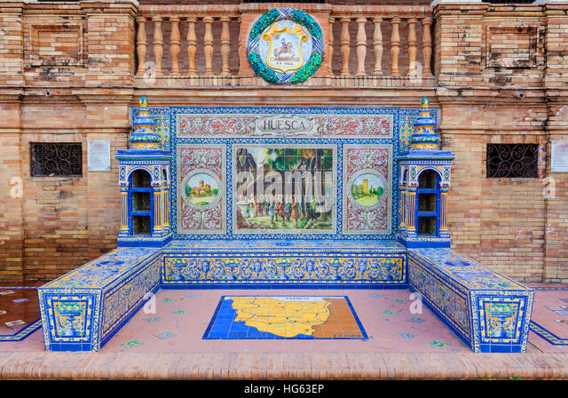 Glazed tiles bench of spanish province of Huesca at Plaza de Espana, Seville, Spain - Stock Image