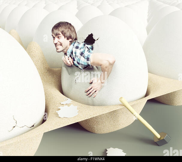 Man hit shell, getting out of eggs. Creative concept - Stock-Bilder