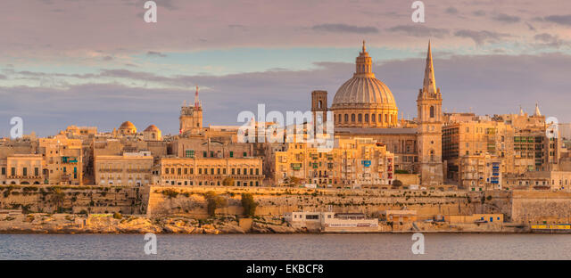 Valletta skyline panorama at sunset with the Carmelite Church dome and St. Pauls Anglican Cathedral, Valletta, Malta - Stock Image