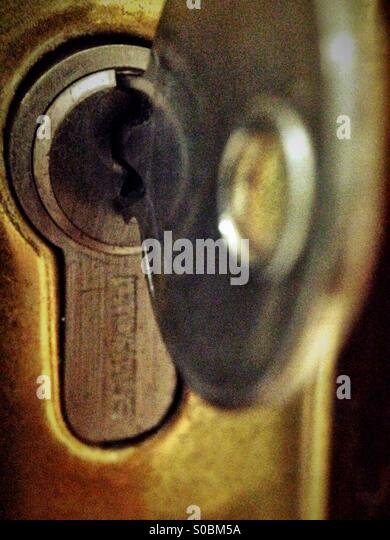 Unlocking the door - Stock-Bilder