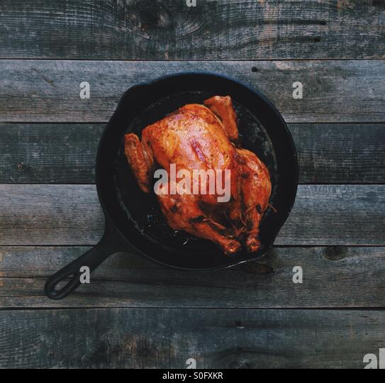 Cast Iron Roast Chicken - Stock Image
