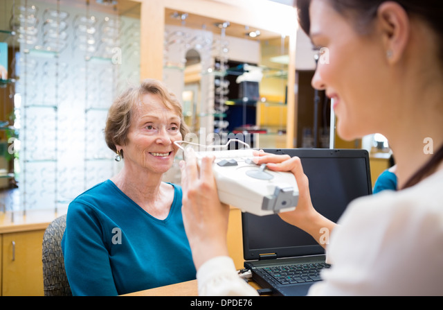 Woman Getting An Eye Test From Ophthalmologist - Stock Image