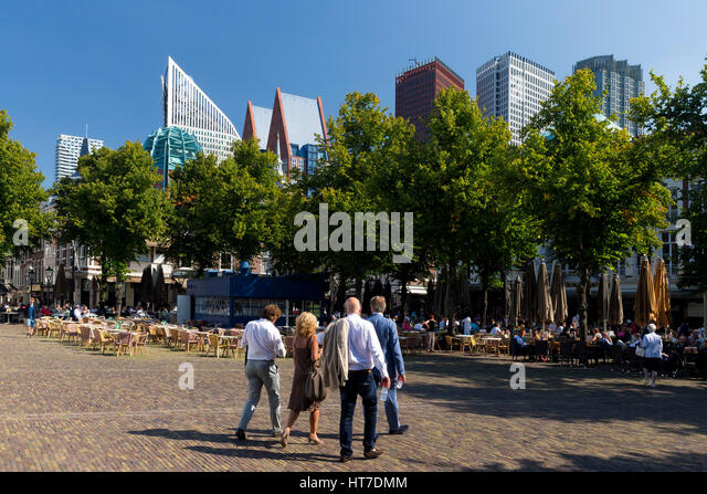 Visitors and tourists in Square Het Plein with Skyscrapers behind, city centre, The Hague, Netherlands, Europe - Stock Image