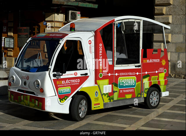 Environmentally Friendly Electric Bus In The Centre Of Granada, Spain - Stock Image