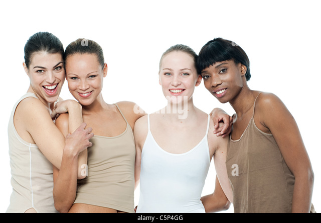 Four happy young women together - Stock Image