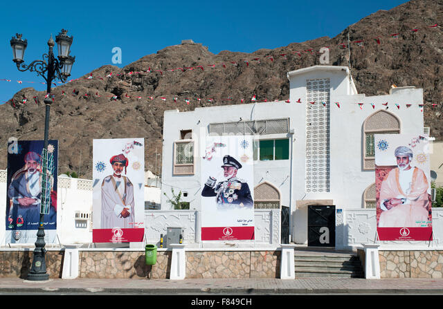 Posters of the Sultan of Oman in Old Muscat, part of the capital of the Sultanate of Oman. - Stock Image