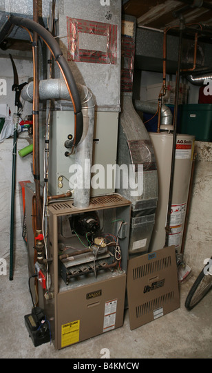 Old low-efficiency gas furnace - Stock Image
