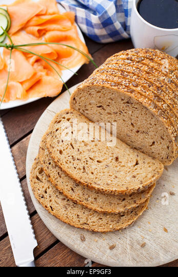 Bread with seeds on a cutting board - Stock Image