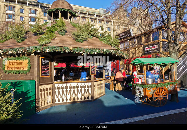 Edinburgh 2014 Christmas Market in Princes Street Gardens Edinburgh Scotland with market stall selling German Bratwurst - Stock Image