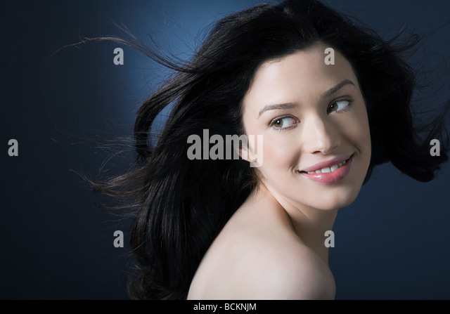 Woman with movement in hair - Stock Image