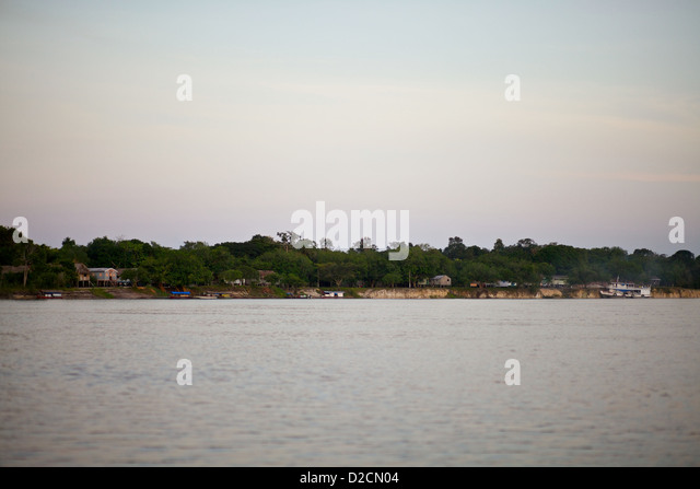 Civilization sits on the edge of the Amazon river surrounded by jungle - Stock Image