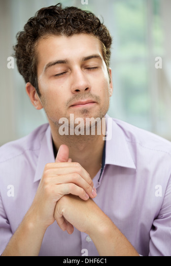 Young man in deep thoughts - Stock Image