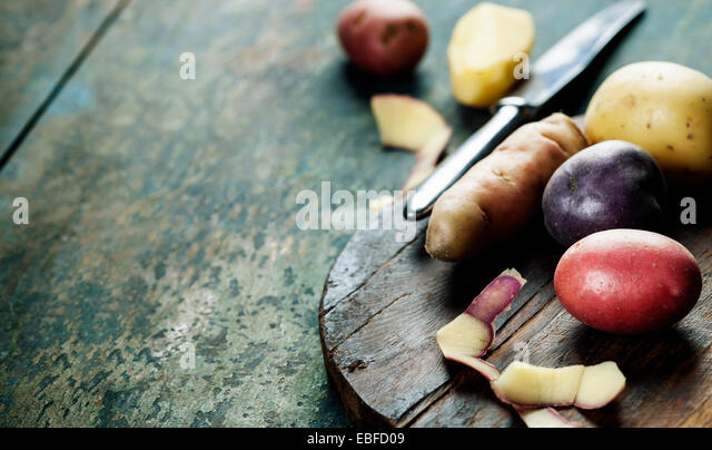Raw colorful potatoes ready for cooking - Stock Image
