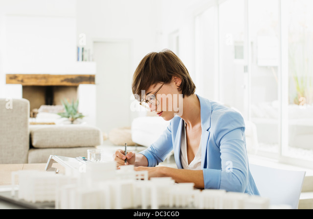 Architect working at drawing board - Stock Image