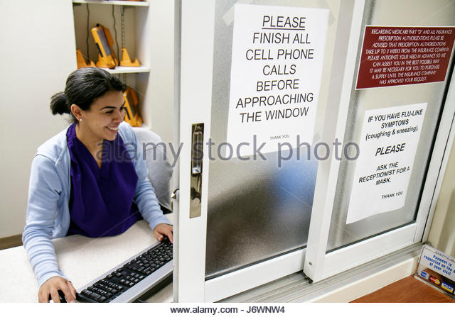 Miami Beach Florida Mount Mt. Sinai Medical Center centre hospital doctor's office Hispanic woman receptionist - Stock Image